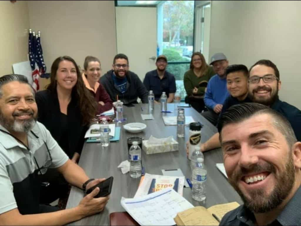 church staff meeting together, selfie